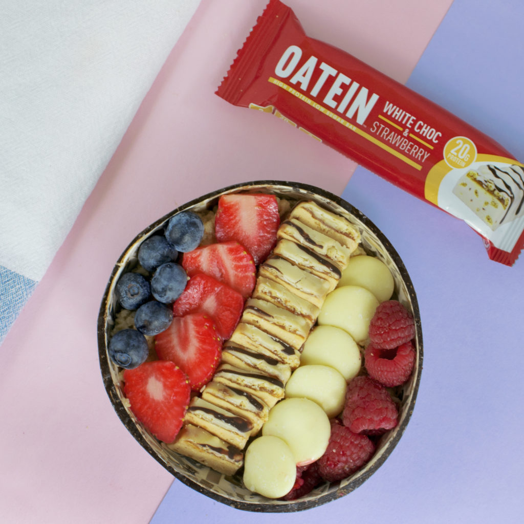 Oatein Breakfast bowl with strawberry and white chocolate Bar